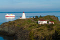 Ferry Passing Lighthouse Stock Image - 73925361