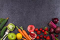 Vegetables And Fruits On Black Background Stock Photo - 73929780