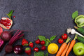 Vegetables And Fruits On Black Background Stock Photography - 73929872