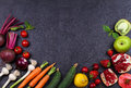 Vegetables And Fruits On Black Background Royalty Free Stock Photos - 73929978