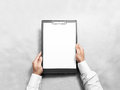 Hand Holding Blank Clip Board With White Paper Design Mockup. Royalty Free Stock Photos - 73949328