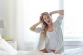 Young Woman Stretching In Bed At Home Bedroom Stock Photography - 74013662