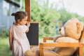 Little Girl Playing With Teddy Bear Royalty Free Stock Photography - 74019447