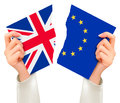 Two Torn Flags - EU And UK In Hands. Brexit Concept. Royalty Free Stock Photos - 74027378