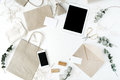 Desk Workspace With Tablet, Phone, Craft Envelopes And Eucalyptus Branches Royalty Free Stock Image - 74047846