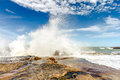 Waves Breaking On The Rocks At Sunset Stock Photos - 74075923