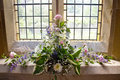 Flowers Near A Church Window Stock Images - 74077044