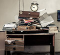 Messy Workplace And Alarm Clock Royalty Free Stock Photo - 74086555