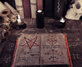 Old Magic Book And Black Candles On Witch Table Royalty Free Stock Photos - 74116148