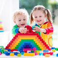 Kids Playing With Colorful Blocks Stock Photography - 74144932