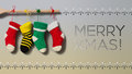 Merry Xmas Text Invitation Card. Hanging Christmas Socks On Gradient Gray Beige Background. Colorful Stocking Decoration Royalty Free Stock Images - 74145039