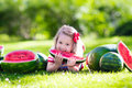 Little Girl Eating Watermelon In The Garden Royalty Free Stock Image - 74145166