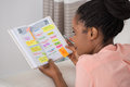 Young Woman Writing Schedule In Diary Stock Images - 74155044