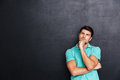 Thoughtful Handsome Young Man Standing And Thinking Royalty Free Stock Photography - 74176537