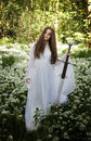 Beautiful Woman Wearing A Long White Dress Holding A Sword Royalty Free Stock Photos - 74195518