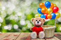 Teddy Bear Holding A Heart-shaped Pillow Royalty Free Stock Images - 74215989