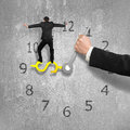 Man Balancing On USD Clock Hand With Another Holding, Concrete W Royalty Free Stock Photos - 74219878