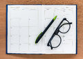 Diary Planner Book Open Calendar Page With Glasses And Pen On Th Royalty Free Stock Photography - 74225967