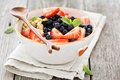 Greek Yogurt Bowl With Fresh Berries And Nuts Stock Photography - 74227772