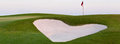Heart Shaped Sand Bunker In Front Of Golf Green Stock Photos - 74241183