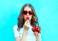 Portrait Pretty Woman With Many Strawberry Over Colorful Blue Stock Images - 74249374
