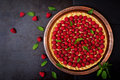 Tart With Raspberries And Whipped Cream Decorated With Mint Leaves On A Black Background. Royalty Free Stock Image - 74255246