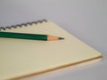 Green Pencil On A Notebook Stock Photography - 74277612