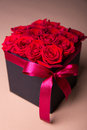 Box With Red Roses Over Beige Background Stock Images - 74281034