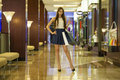 Young Brunette Woman With Some Shopping Bags In The Mall Royalty Free Stock Image - 74295056