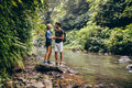 Loving Couple Standing By A Mountain Stream Royalty Free Stock Images - 74295589
