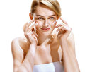 Portrait Of Young Woman Applying Moisturizer Cream On Her Pretty Face. Stock Photos - 74295863