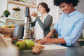 Two Women Working At Juice Bar Royalty Free Stock Photo - 74296645