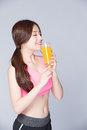 Young Girl Drink Orange Juice Stock Photos - 74321673