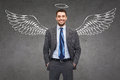 Smiling Businessman With Angel Wings And Nimbus Stock Photography - 74336912
