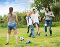 Teenagers Playing Football In Park Royalty Free Stock Photography - 74351687