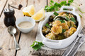 Baked Cauliflower And Broccoli With A Sauce Of Tahini In A White Ceramic Plate Stock Photos - 74358143