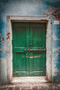 Old Wooden Locked Green Door Stock Photo - 74362570