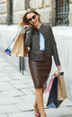 Beautiful Woman With Shopping Bags In The Ctiy Stock Image - 74377531