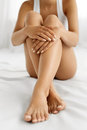 Woman Body Care. Close Up Of Long Legs With Soft Skin And Hands Royalty Free Stock Photography - 74382147