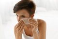 Skin Care. Woman Cleaning Face With Oil Absorbing Papers. Royalty Free Stock Image - 74382746