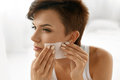 Skin Care. Woman Cleaning Face With Oil Absorbing Papers. Stock Photos - 74382833