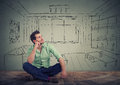 Dreaming Man Isolated Over Drawn Living Room Background. Stock Images - 74385724