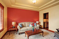 Cozy Sitting Room With Antique Beige Sofa And Red Wall Behind. Stock Image - 74395331