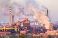 Industrial Landscape In Ukraine. Steel Factory At Sunset. Pipes With Smoke. Metallurgical Plant. Steelworks, Iron Works Royalty Free Stock Photo - 74410465