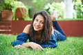 Teenager Laying On Grass Stock Photography - 74432462