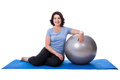 Happy Mature Woman Sitting On Yoga Mat With Fitness Ball Isolate Stock Photo - 74459250