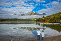 Two Boys Looking At A Lake Holding Hands Royalty Free Stock Photography - 74479387
