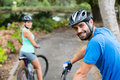 Athletic Couple Standing With Mountain Bike In Forest Stock Photography - 74503512