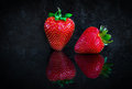 Two Strawberries On Black Background Stock Images - 74506874