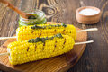 Grilled Corn On Cob With Pesto Sauce On Wooden Board Stock Photos - 74526553